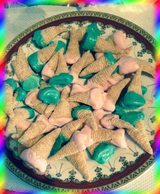 Bugles Dipped In Chocolate = Elves Hats?  :)
