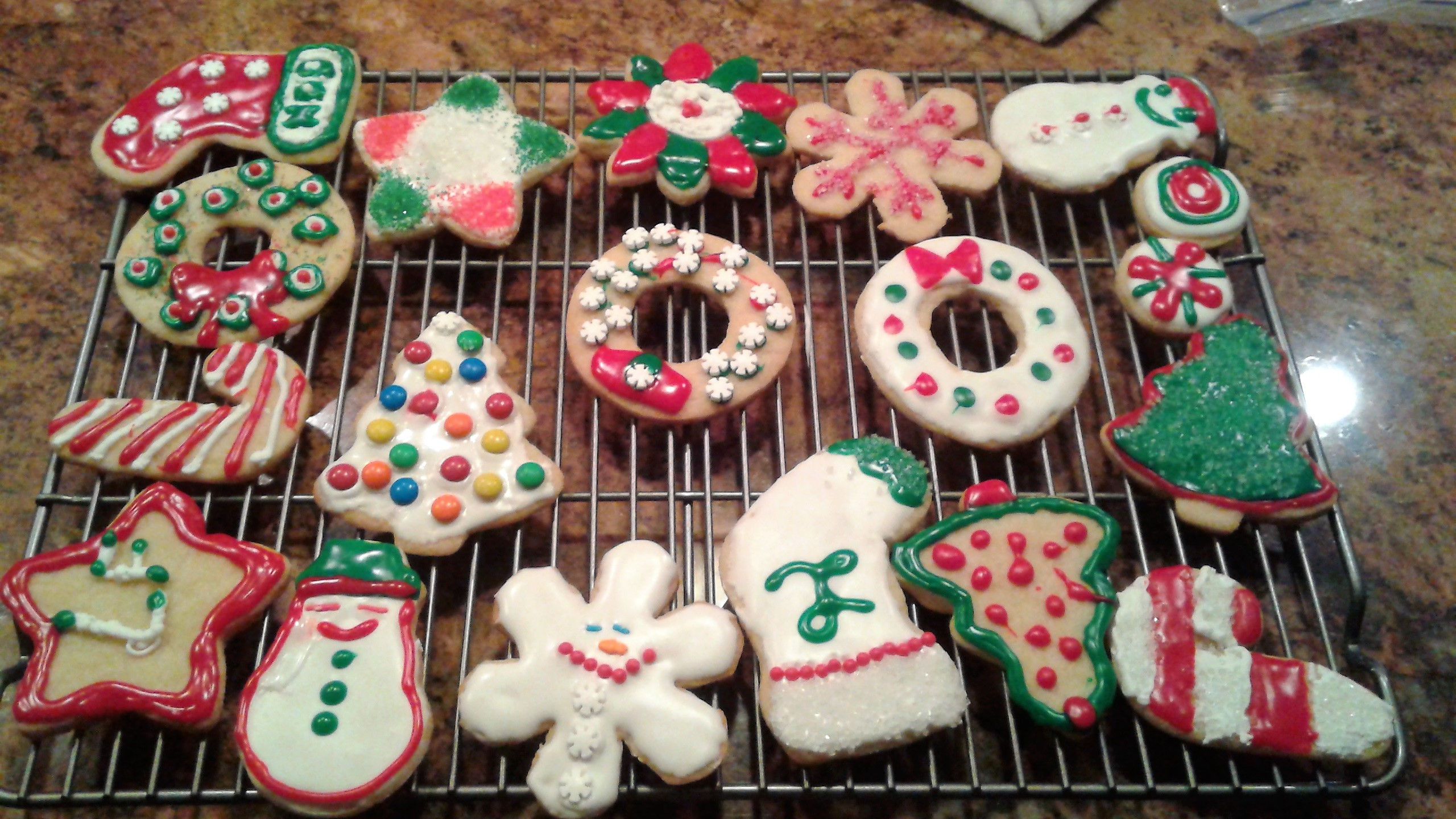 we also ended up making decorated sugar cookies shaped like christmas trees wreaths snowmen candy canes stars and more just look at some of these cute - Making Christmas Cookies