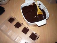 filling chocolate molds
